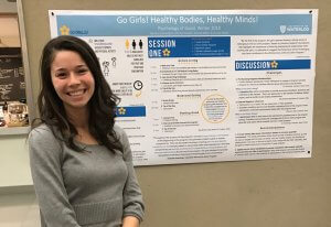 Amanda's friend with her project poster on Go Girls!